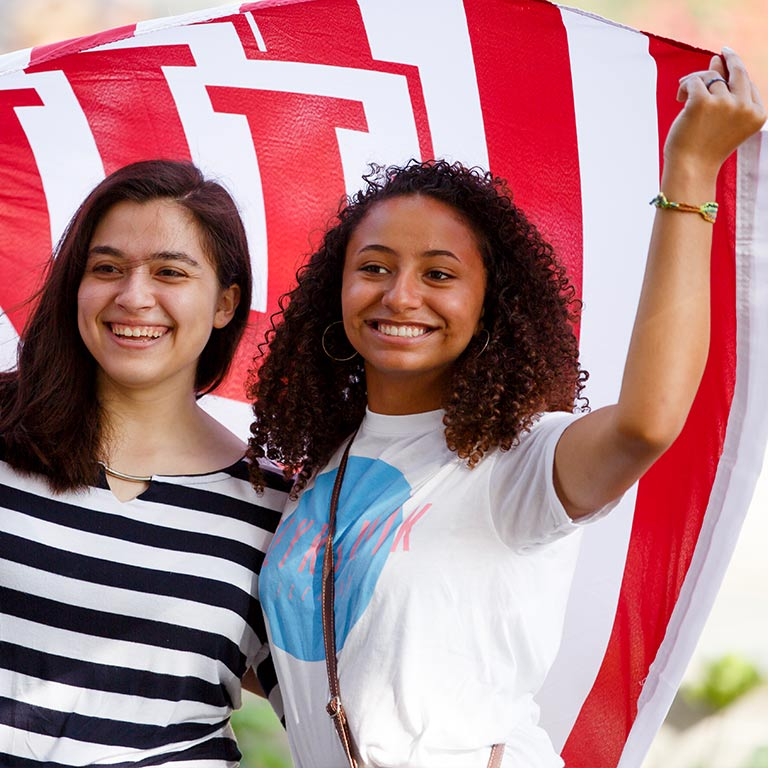 Students hold an IU flag.
