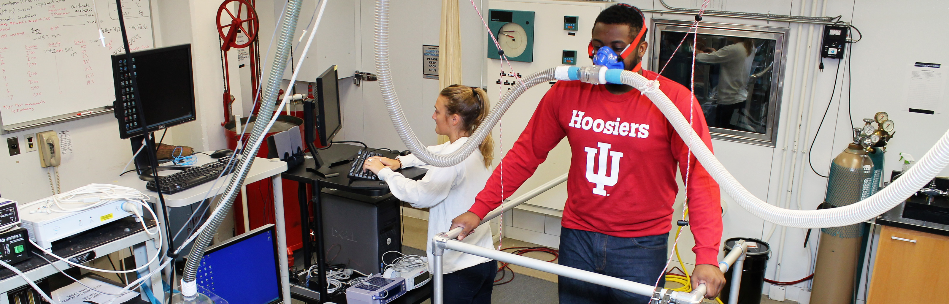 Health students measure physical fitness in a lab setting.