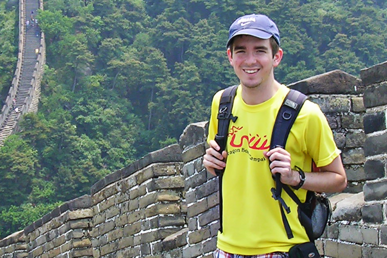 An IU student stands on the Great Wall of China.