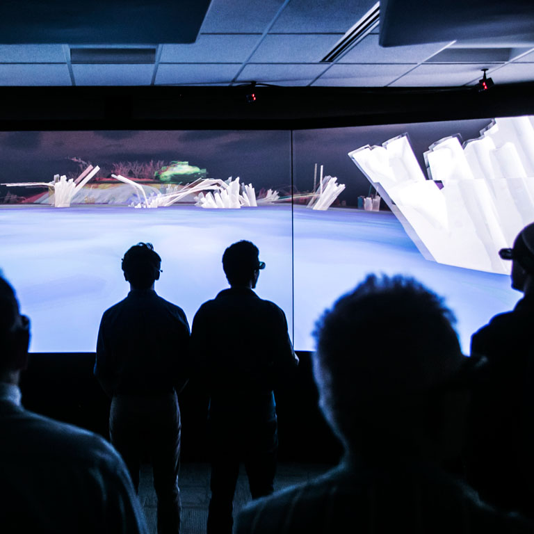 Students in front of a 3D wall