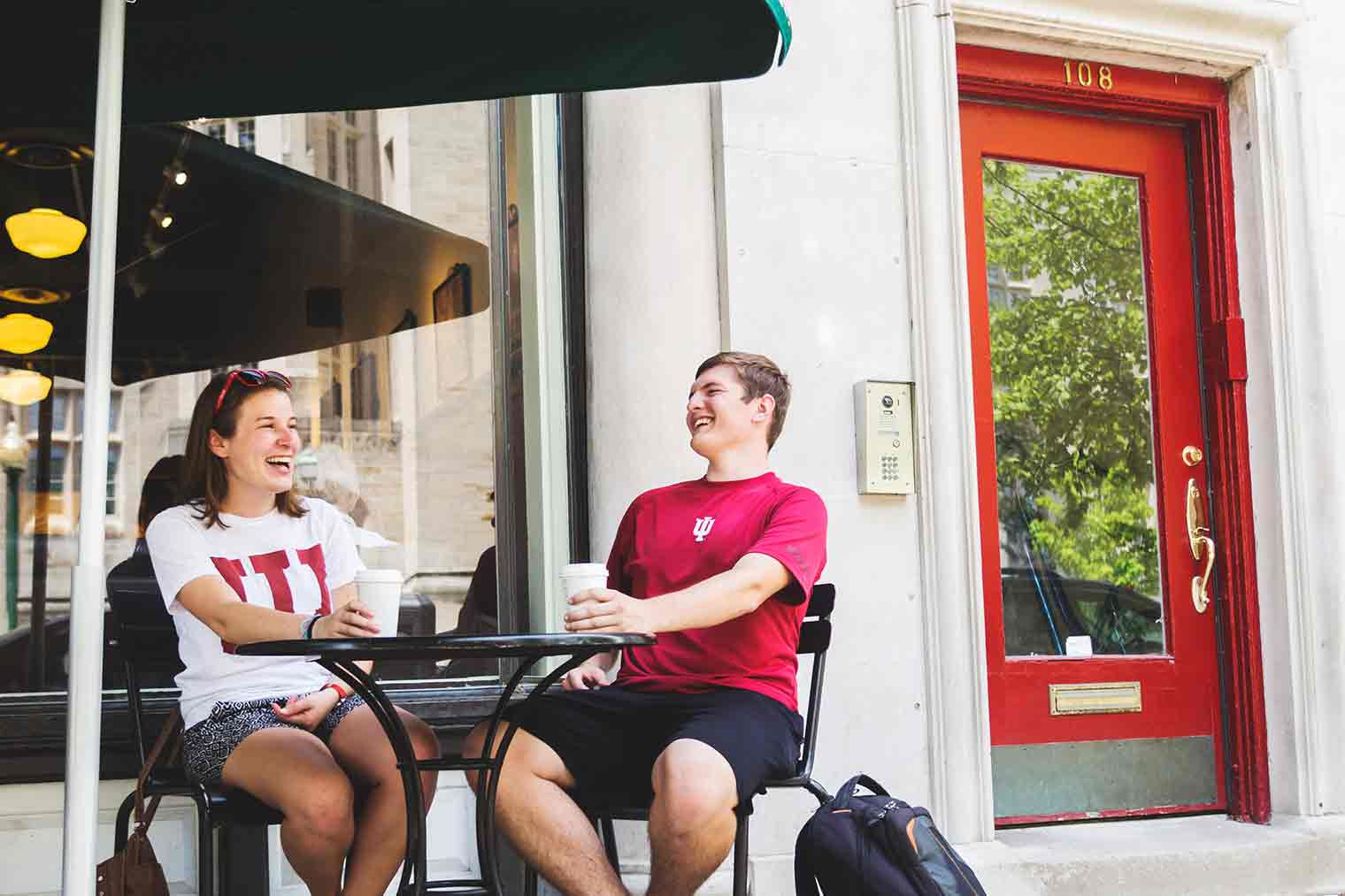 IU Students with coffee laughing outside