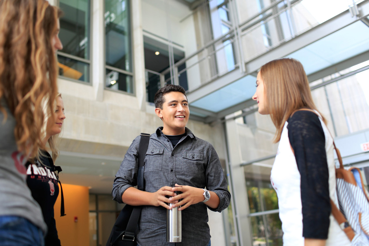 Students having a conversation at the SGIS building
